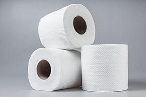 Stack of white tissue paper rolls.